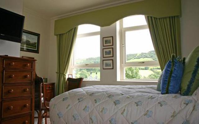 Tasteful and comfortable bedrooms with views ove the Hope Valley landscape